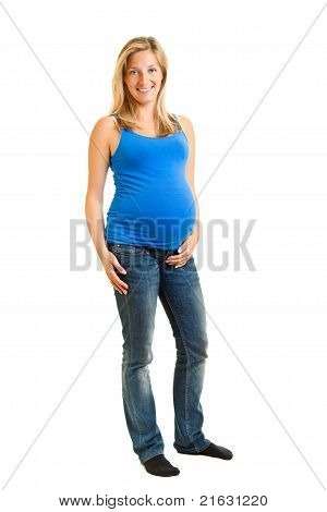 Pregnant woman isolated on white in blue shirt