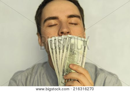 Sick Young Man Using Throat Spray On Color Background