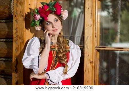 Russia Moscow Izmaylovsky Park August 27 2017. International Photo Festival.Beautiful woman portrait in russian style. Beautiful Russian girl in traditional dress. Russian style.