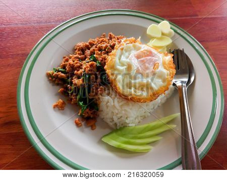 Street food in Thailand. rice with stir-fried of pork and basil leaf with fried egg hot and spicy.
