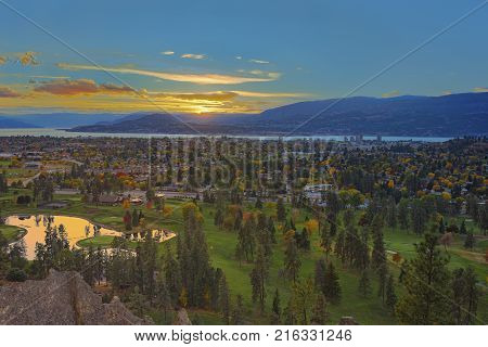 Kelowna golf course at sunset with Okanagan Lake in the Background with fall colours Kelowna British Columbia Canada