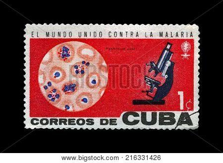 CUBA - CIRCA 1962: canceled stamp printed in Cuba shows World Health Organization campaign to eradicate malaria, microscope and blood macro, circa 1962.