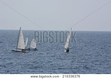 YALTA, CRIMEA SEPTEMBER 16, 2017: Tourists having a rest on the Black Sea on floating means