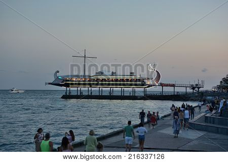 YALTA CRIMEA SEPTEMBER 6 2017: View of the evening embankment of the city of Yalta