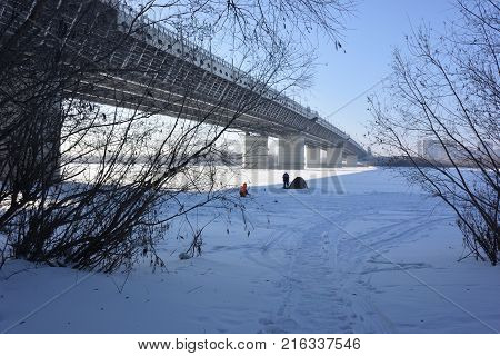 OMSK RUSSIA - JANUARY 31 2017: Bridge over the Irtysh river named after the 60th anniversary of Victory Omsk Siberian region Russia