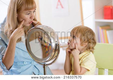 Kid preschooler boy at speech therapist office