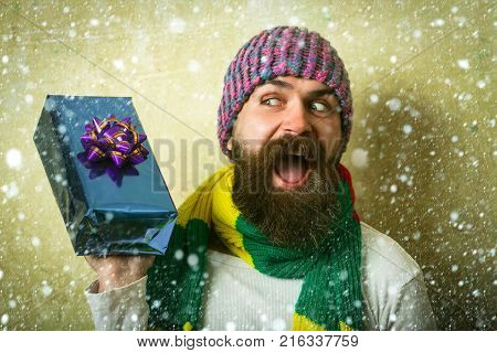 Christmas Man With Beard On Serious Face At Present Box.