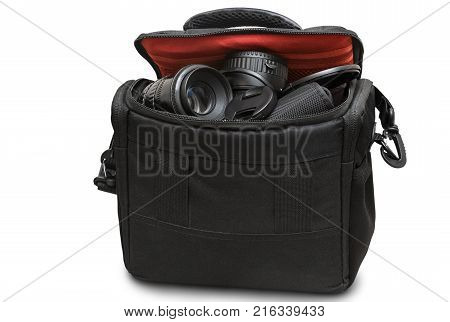 Black bag with camera and accessories. Presented on a white background.