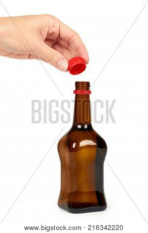 Glass bottle with soy sauce in hand isolated on white background. Asian food.