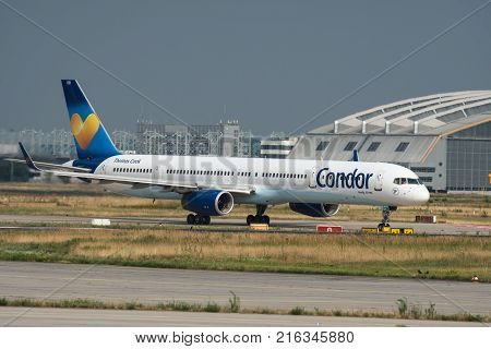 FRANKFURT AM MAIN GERMANY - JULY 19 2017: Side view of Boeing 757-300 of Condor airlines Thomas Cook on taxiway at Frankfurt am Main airport