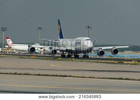 FRANKFURT AM MAIN GERMANY - JULY 19 2017: Jumbojet Boeing 747 of Lufthansa airlines prepares to take off on runway in Frankfurt am Main airport