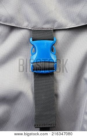 Blue plastic clasp of backpack close-up. New accessories for backpack.