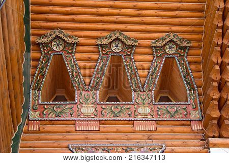 Wooden architecture. Russian block. Painted windows of ancient buildings