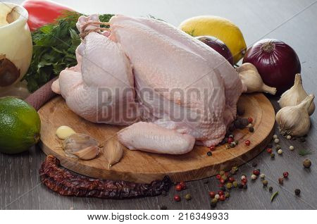 Fresh raw chicken composition on a wooden background