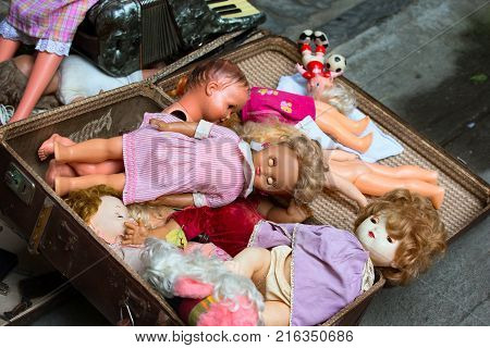Old dolls. Old dolls in an old suitcase. Retro Dolls