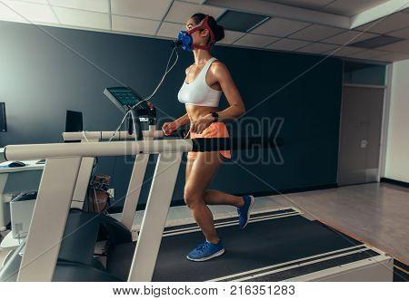 Female Runner On Treadmill At Biomechanics Lab