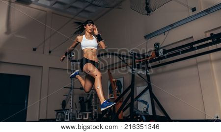 Female Runner On Treadmill At Biomechanics Lab