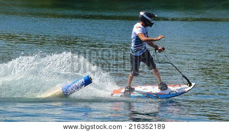 WYBOSTON, BEDFORDSHIRE, ENGLAND - JULY 08, 2017: Male Motosurf Competitor Taking very tight line around marker.