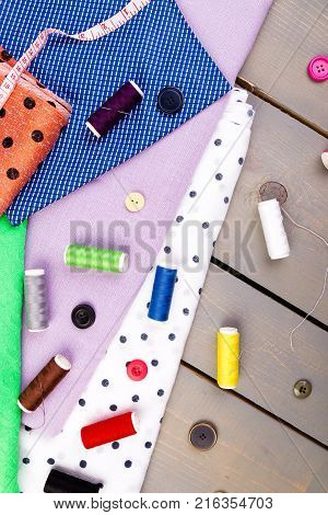 Items For Sewing Clothes. Sewing Buttons, Spools Of Thread And Cloth. Top View.