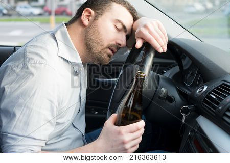 Drunk man driving car and falling asleep at the wheel
