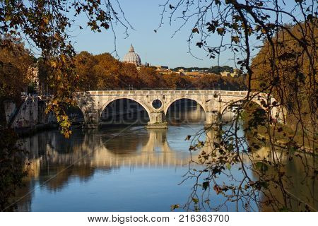 Rome Italy Europe - scenic view of a bridge over Tiber river on background Saint Peter basilica dome