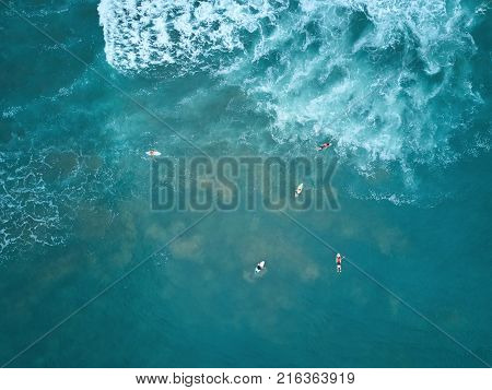 Surfers catching big wave above drone view. Surfer wait for wave