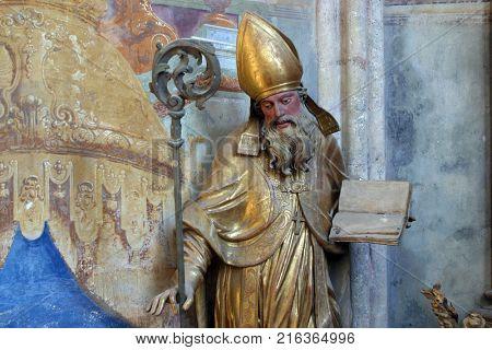 LEPOGLAVA, CROATIA - AUGUST 08: Saint Ambrose statue in the church of Immaculate Conception in Lepoglava, Croatia on August 08, 2017.