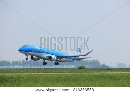 Amsterdam the Netherlands - May 6th 2017: PH-EXK KLM Cityhopper Embraer ERJ-175STD takeoff from Polderbaan runway Amsterdam Schiphol Airport