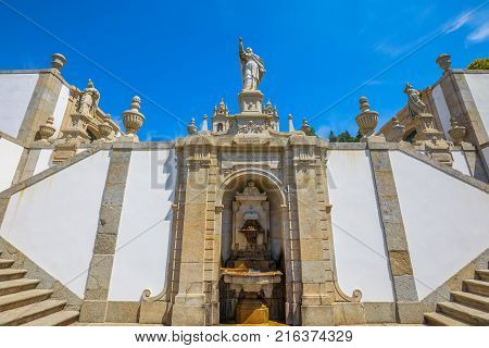 Bom Jesus do Monte Sanctuary, a popular pilgrimage site in northern Portugal, Tenoes in Braga. Fountain on a monumental baroque staircase of 116 meters. Perspective view from down to up. poster