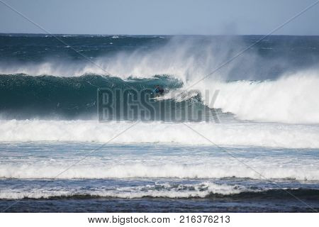 surfer in a big wave fuerteventura canary islands