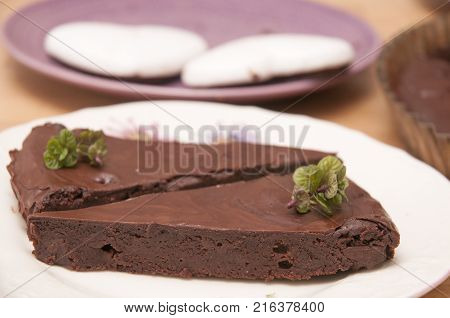 It is image of delicious chocolate vegan cake with mint and decoration