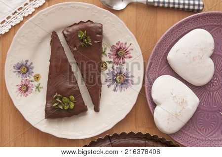It is image of delicious chocolate cake with mint and decoration