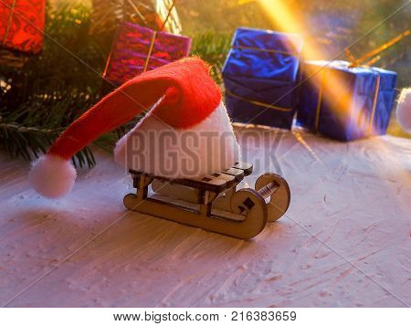 Christmas Still Life Of A Toy Sled, Vintage Photo, Gifts For Christmas On Wooden Sled, Merry Christm