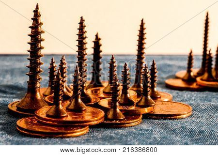 Diorama of an island in the sea made with copper scres anc copper coin, screws as trees, coin as land