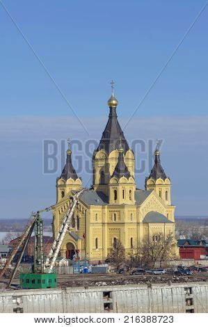 Nizhny Novgorod, Russia. - March 14.2017 The Cathedral of Alexander Nevsky in the foreground the remnants of the River Port, a concrete mooring berth. The highest temple of Alexander Nevsky in Russia.