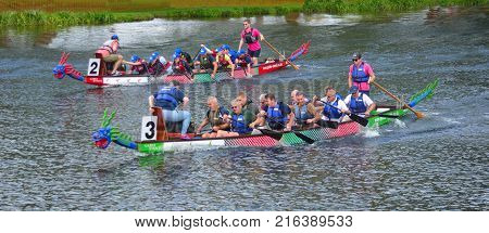 ST NEOTS, CAMBRIDGESHIRE, ENGLAND - AUGUST 19, 2017: Dragon boat racing on the river Ouse St Neots Cambridgeshire.