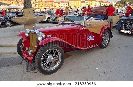 ROVINJ, ISTRIA, CROATIA - JUNE 25, 2017: Classic Red MG Sports Car in  town square Rovinj in tour of Croatia.