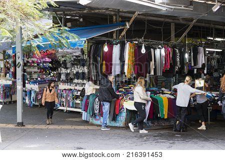 TEL AVIV , ISRAEL - 21 NOVEMBER 2017: Sellers on the old grocery street Nahalat-Benjamin