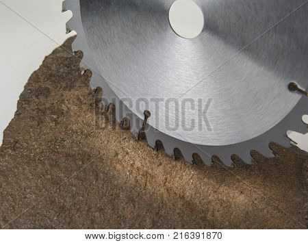 Circular saw blade for wood work on the stone background