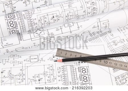Electronics and Engineering. Pencil and ruler on printed drawings of electrical circuits