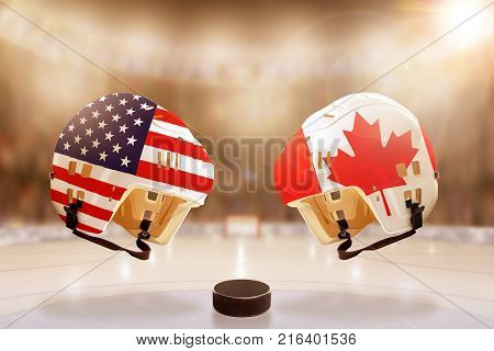 Low angle view of hockey helmets with Canada and USA flags painted and hockey puck on ice in brightly lit stadium background. Concept of intense rivalry between the two hockey nations.