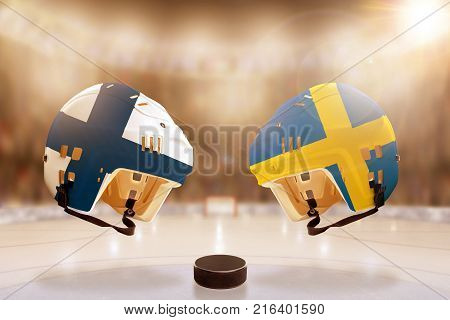 Low angle view of hockey helmets with Finland and Sweden flags painted and hockey puck on ice in brightly lit stadium background. Concept of intense rivalry between the two hockey nations.