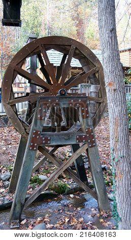 Rusty old water wheel sitting in water