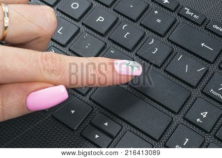 Close up view of a Finger Pushing on a empty Button of computer Keyboard. Finger Pressing a Slim Aluminium Keyboard Button. Modern Laptop Keyboard. Empty space for text