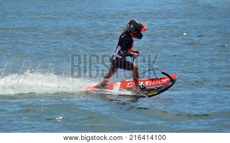 WYBOSTON, BEDFORDSHIRE, ENGLAND - JULY 08, 2017: Female Motosurf Competitor moving at speed.