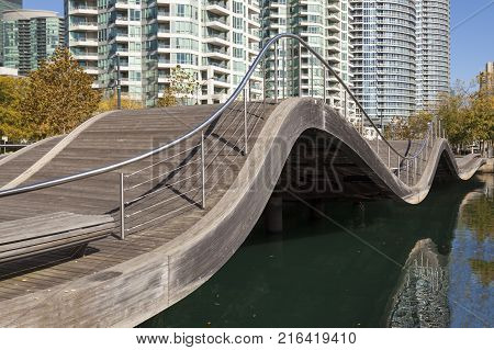 Toronto Canada - Oct 20 2017: The Toronto Waterfront Wavedecks - a wave shaped pedestrian bridge at the waterfront promenade in Toronto Canada