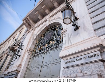 ATHENS GREECE - NOVEMBER 4 2017: Main entrance of the National Bank of Greece the central bank of the country at dusk. The bank is a key element to the handling of the Greek economic crisis