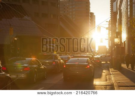 Toronto Canada - Oct 21 2017: Rush hour in Toronto downtown financial district at sunset. City of Toronto Canada