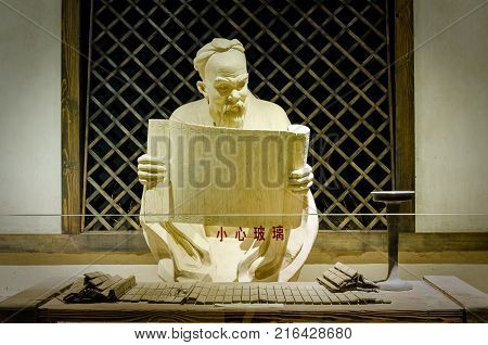 Beijing, China - Septemper, 21th 2016: Statue of Confucius,in Beijing Imperial Academy and the Confucian Temple Museum