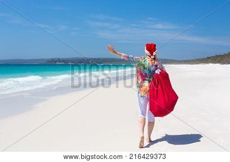 Celebrate Christmas In Australia - Female Jumping For Joy On Beach